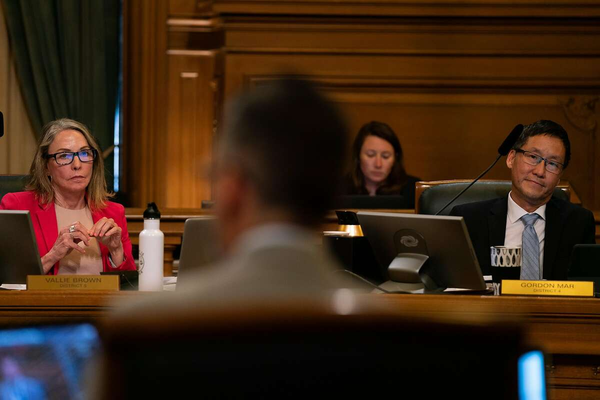 Supervisors Vallie Brown (left) and Gordon Mar (right), listen as Ahsha Safa' (center) speaks about legislation that would ban the sale of e-cigarettes at City Hall in San Francisco, Calif., on Tuesday, June 18, 2019.