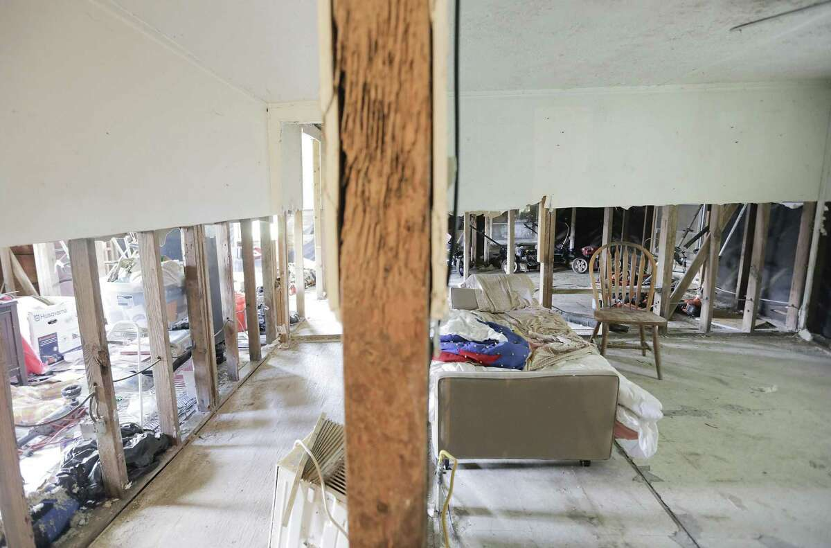 The hallway of Joe Fowler's home, still gutted and with light seeping in from holes to the outdoors as a result of early demolition from Harvey. Homes in Kashmere Gardens still are in need of renovation, almost two years after Harvey on Tuesday, June 18, 2019 in Houston.