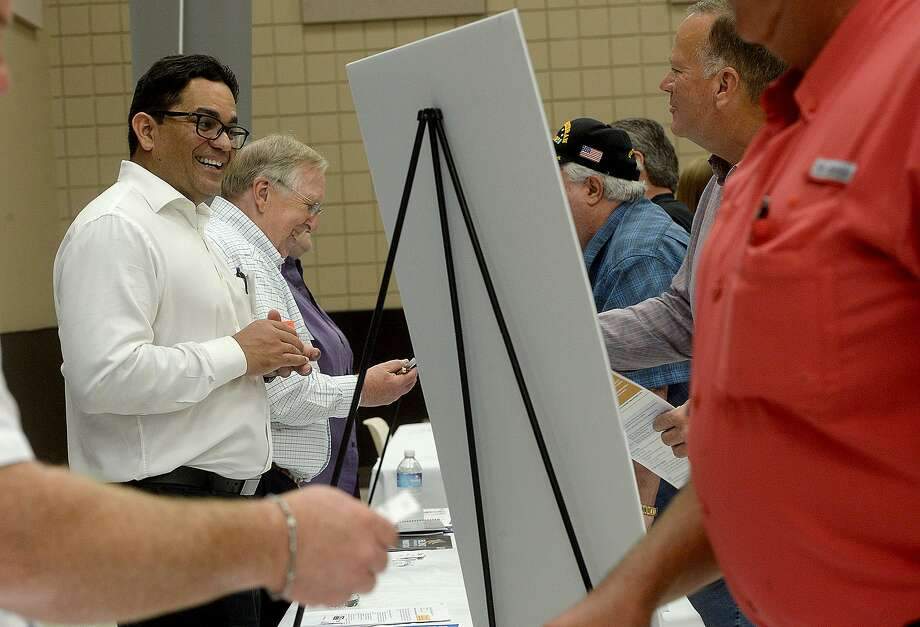 Booth operators and attendees, including Francisco Toro (left) and Eric McGuire, mingle and discuss business opportunities during the Golden Pass LNG forum held at the Bob Bowers Civic Center in Port Arthur Tuesday. Area vendors, contractors and other business were invited to learn more about the Golden Pass LNG export project. Photo taken Tuesday, June 18, 2019 Kim Brent/The Enterprise Photo: Kim Brent / The Enterprise / BEN