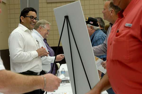 Booth operators and attendees, including Francisco Toro (left) and Eric McGuire, mingle and discuss business opportunities during the Golden Pass LNG forum held at the Bob Bowers Civic Center in Port Arthur Tuesday. Area vendors, contractors and other business were invited to learn more about the Golden Pass LNG export project. Photo taken Tuesday, June 18, 2019 Kim Brent/The Enterprise