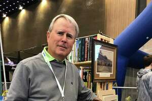 Mike Daniels, an Albany native, at his golf memorabilia booth at the Empire Golf and Travel Expo at the Albany Convention Center in March 2019. He is co-owner of a golf memorabilia shop in Pinehurst, North Carolina, and travels to golf shows after playing and starting a sports awards business in the Capital Region 30 years ago. He now lives in Murrells Inlet, South Carolina. (Joyce Bassett / Times Union)