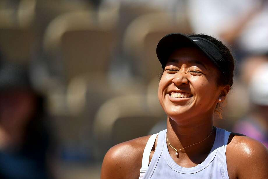 Japan's Naomi Osaka reacts as she plays against Czech Republic's Katerina Siniakova during their women's singles third round match on day seven of The Roland Garros 2019 French Open tennis tournament in Paris on June 1, 2019. (Photo by Martin BUREAU / AFP)MARTIN BUREAU/AFP/Getty Images Photo: MARTIN BUREAU;Martin Bureau / AFP / Getty Images