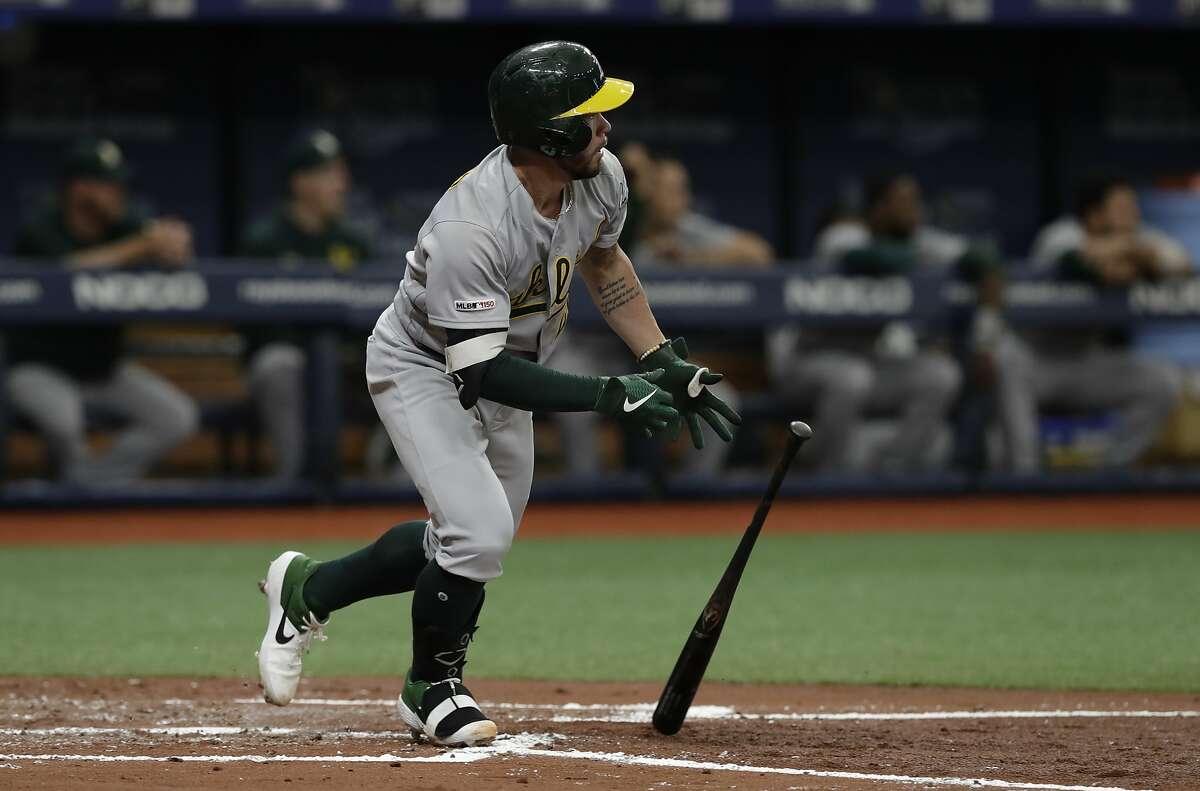 Oakland Athletics' Beau Taylor singles off Tampa Bay Rays relief pitcher Yonny Chirinos during the third inning of a baseball game Wednesday, June 12, 2019, in St. Petersburg, Fla. (AP Photo/Chris O'Meara)