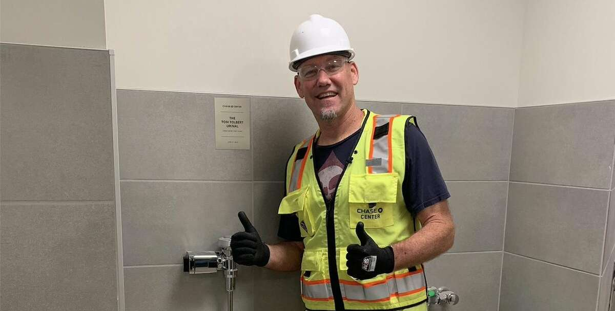 Tom Tolbert stands with the urinal honoring him at the Chase Center. Click through the gallery for a look at the greatest Warriors memories and moments in Oakland, before moving to the Chase Center.