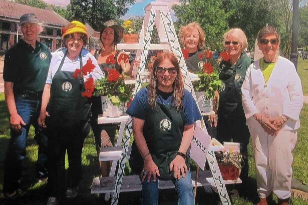 The Garden Club of New Milford held its annual plant sale May 25 on the Village Green. Several members are shown above during the festivities. They are, from left to right, in front, Jacquie McCloskey, and in back, Elizabeth O'Connor, Pat Hurley, Andrea Johnson, Sandy Gammons, Ann Stone and Barbara Clark.