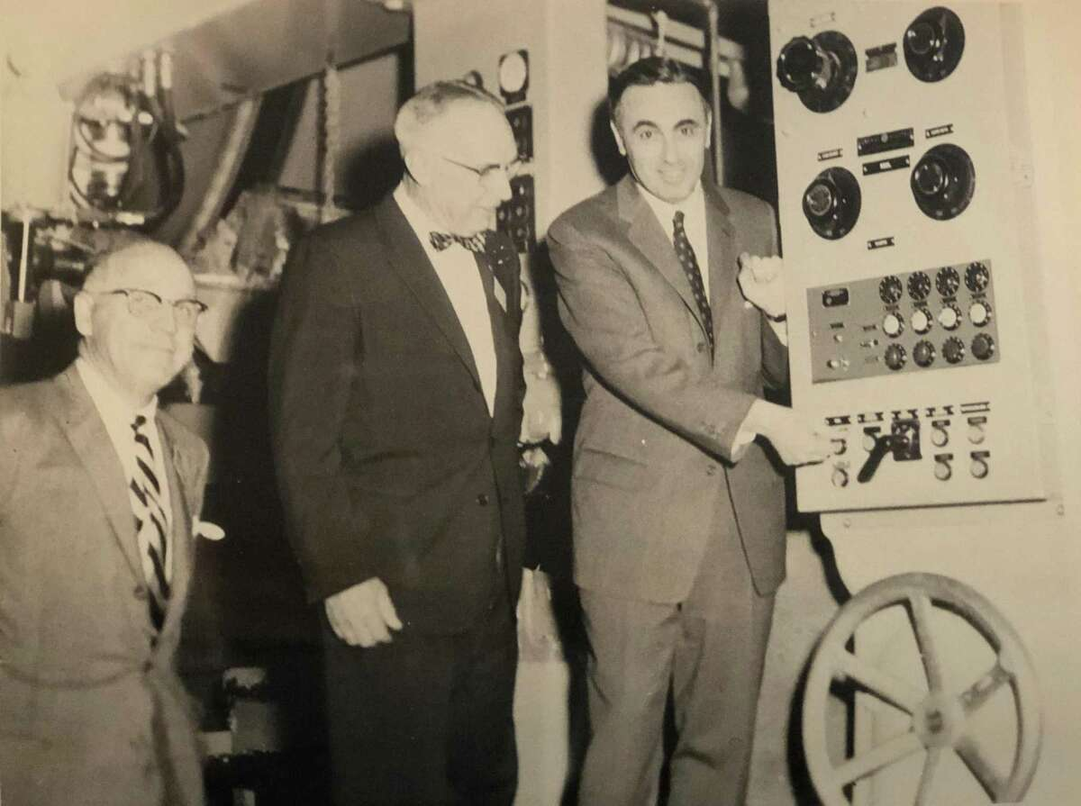 Governor Abraham Ribicoff pushes the button to officially start operations at the new Kimberly-Clark mill on Pickett District Road in New Milford April 21, 1958. To his right is then-First Selectman E. Paul Martin. Joining them is William Kellett, president of the Kimberly-Clark Corp. If you have a