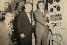 """Governor Abraham Ribicoff pushes the button to officially start operations at the new Kimberly-Clark mill on Pickett District Road in New Milford April 21, 1958. To his right is then-First Selectman E. Paul Martin. Joining them is William Kellett, president of the Kimberly-Clark Corp. If you have a """"Way Back When"""" photo you'd like to share, contact Deborah Rose at drose@newstimes.com or 860-355-7324."""