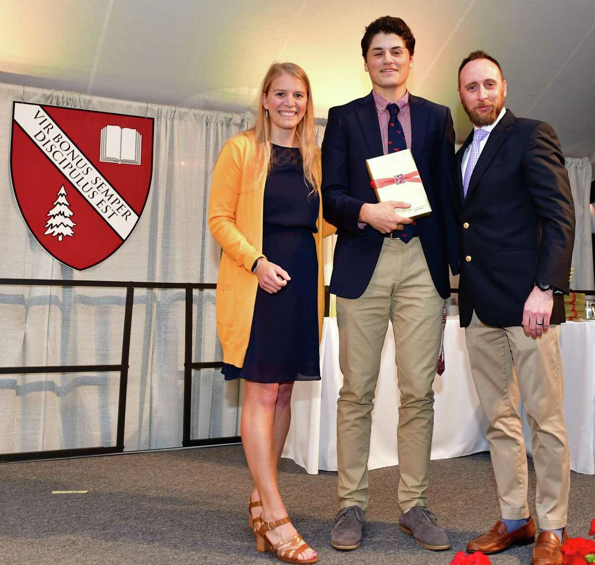 Graduate Julian Aviles of Kent accepts the Percy B. Wightman Prize from Rebeca Leclerc, director of outdoor programs, and Ryan Cotter, co-chair of The Gunnery LEADS Program.