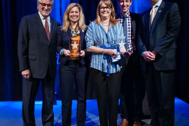 """Hilary Criollo, owner of Hopkins Vineyard in Warren, second from right, and Rebecca Eddy, agriculture marketing and inspection representative with Connecticut Farm Wine Development Council, second from left, recently each received the 2019 Connecticut Tourism Award for Tourism Partners of the Year. The awards were presented at the annual Connecticut Conference on Tourism May 8, 2019. Criollo is vice president of the Connecticut Vineyard and Winery Association. Eddy has led the marketing for the Connecticut Farm Wine Development Council's popular """"Passport to Connecticut Farm Wineries"""" program since 2014. Together, these individuals and organizations drive visitation and sales to Connecticut wineries, and support the state's overall economy. Eddy and Criollo are shown above with, from left to right, Randy Fiveash, director of the Connecticut Office of Tourism, David Kooris, deputy commissioner of the Connecticut Department of Economic and Community Development, and Bryan Hurlburt, commissioner of the Connecticut Department of Agriculture."""