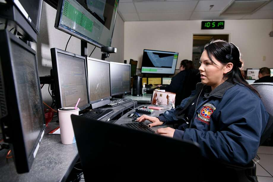 Jennifer Chavarria takes a 911 call at the Alameda County Fire Department dispatch center in Livermore. Workers across California are racing to adopt a cohesive emergency alert system. Photo: Michael Short / Special To The Chronicle 2017