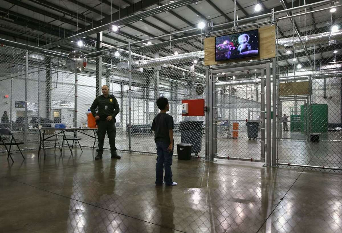 A boy from Honduras watches a movie at a detention facility run by the U.S. Border Patrol in McAllen, Texas.