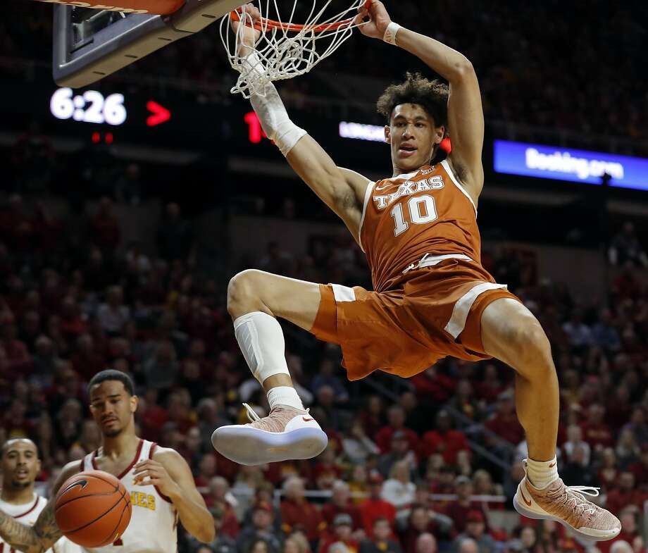 FILE - In this Feb. 2, 2019, file photo, Texas forward Jaxson Hayes (10) dunks the ball over Iowa State guard Nick Weiler-Babb, left, during the first half of an NCAA college basketball game, in Ames, Iowa. Hayes needed only a year at Texas to put himself at the front of the class of big men in the NBA draft coming Thursday, June 20, 2019. (AP Photo/Charlie Neibergall, File) Photo: Charlie Neibergall / Associated Press