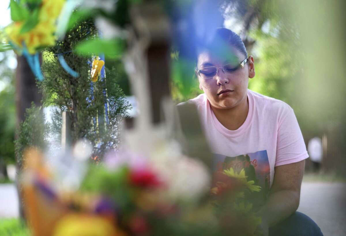 """Jessica Molina prays at the site where Josue Flores, an 11-year-old boy, was stabbed to death in May 2016, on Tuesday, June 18, 2019, in Houston. """"I have three daughters, and I couldn't even start to imagine how his momma feel,"""" Molina said. """"I don't recall anything being done to a child this ugly, it hit everybody hard."""" Harris County District Attorney Kim Ogg announced that a murder indictment was handed down by a grand jury Tuesday morning against Andre Jackson."""