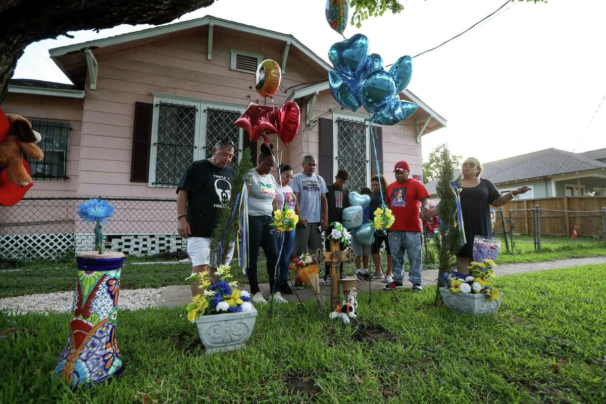 A group of people pray at the site where Josue Flores, an 11-year-old boy, was stabbed to death in May 2016, on Tuesday, June 18, 2019, in Houston. Harris County District Attorney Kim Ogg announced that a murder indictment was handed down by a grand jury Tuesday morning against Andre Jackson.