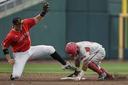 Arkansas' Christian Franklin, right, steals second base against Texas Tech shortstop Josh Jung (16), in the third inning of an NCAA College World Series baseball game in Omaha, Neb., Monday, June 17, 2019. (AP Photo/Nati Harnik)