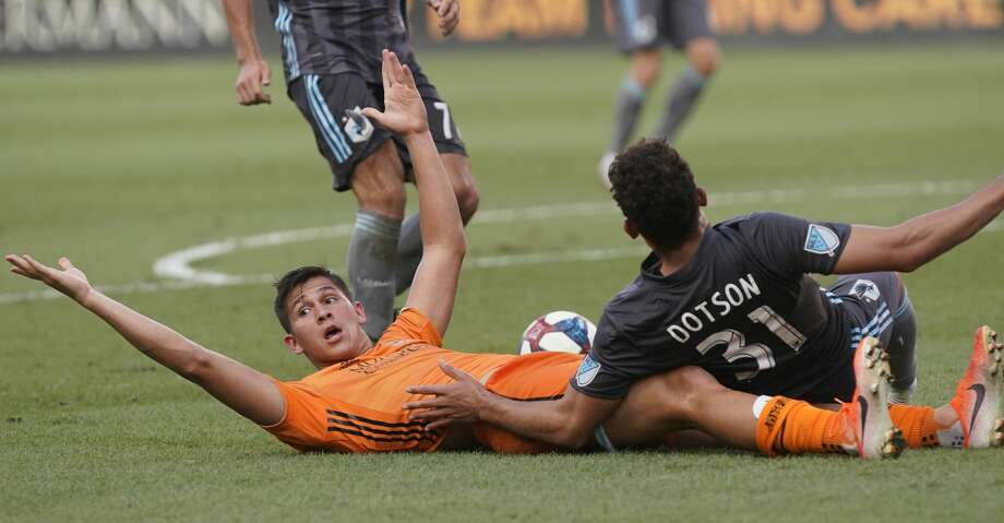 Houston Dynamo Ronaldo Pena looks for a call after he and Minnesota United FC Hassani Dotson tangle over ball during the first half of game at BBVA Stadium Tuesday, June 18, 2019, in Houston. Photo: Melissa Phillip/Staff Photographer