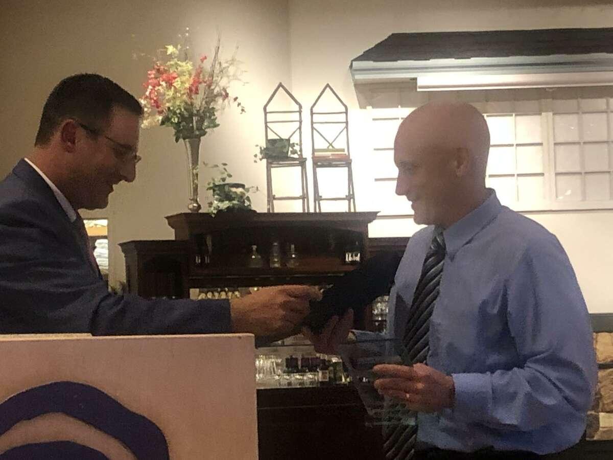 Patrick Richardson receivs his award from Civics First president Jonathan Weiner.