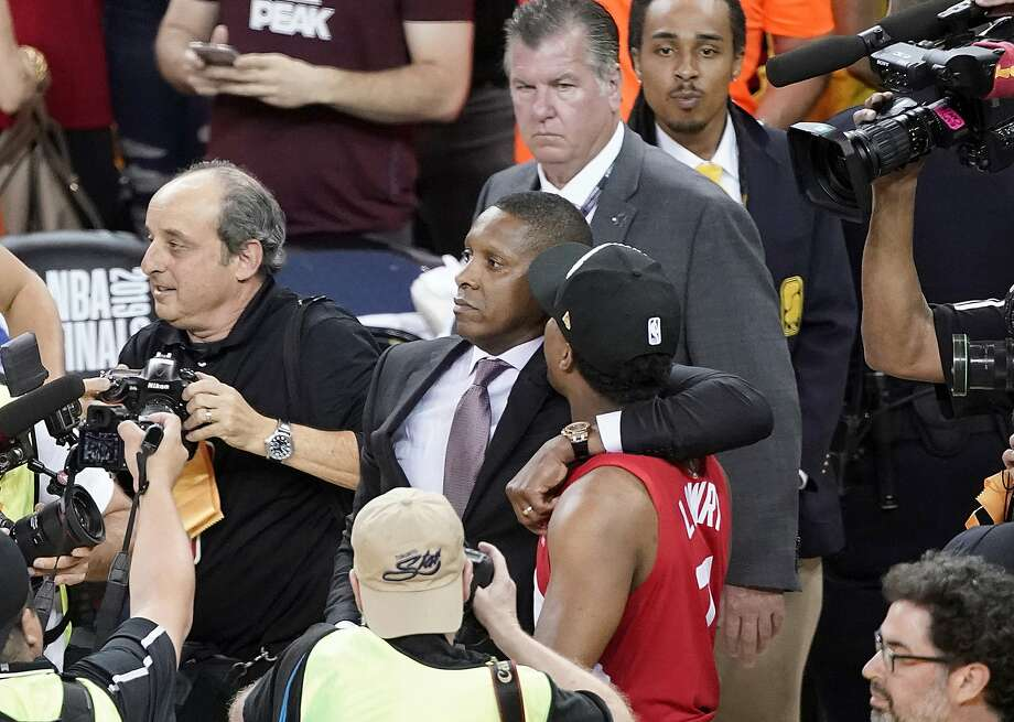 FILE - This Thursday, June 13, 2019, file photo, Toronto Raptors general manager Masai Ujiri, center left, walks with guard Kyle Lowry after the Raptors defeated the Golden State Warriors in Game 6 of the NBA Finals in Oakland, Calif. An attorney for a deputy involved in an altercation with Ujiri as he tried to join his team on the court to celebrate their NBA championship, said his client suffered a concussion and is on medical leave. Attorney David Mastagni said Tuesday, June 18, 2019, the 20-year-veteran of the Alameda County Sheriff's Office has a jaw injury and is considering filing a lawsuit. (AP Photo/Tony Avelar, File) Photo: Tony Avelar / Associated Press