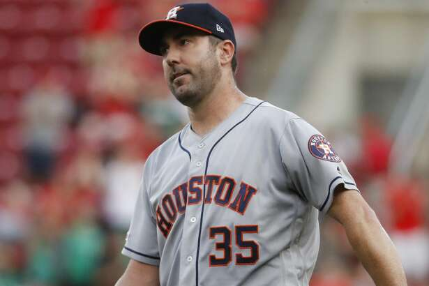 Houston Astros starting pitcher Justin Verlander reacts after giving up a two-run home run to Cincinnati Reds' Derek Dietrich during the first inning of a baseball game Tuesday, June 18, 2019, in Cincinnati. (AP Photo/John Minchillo)