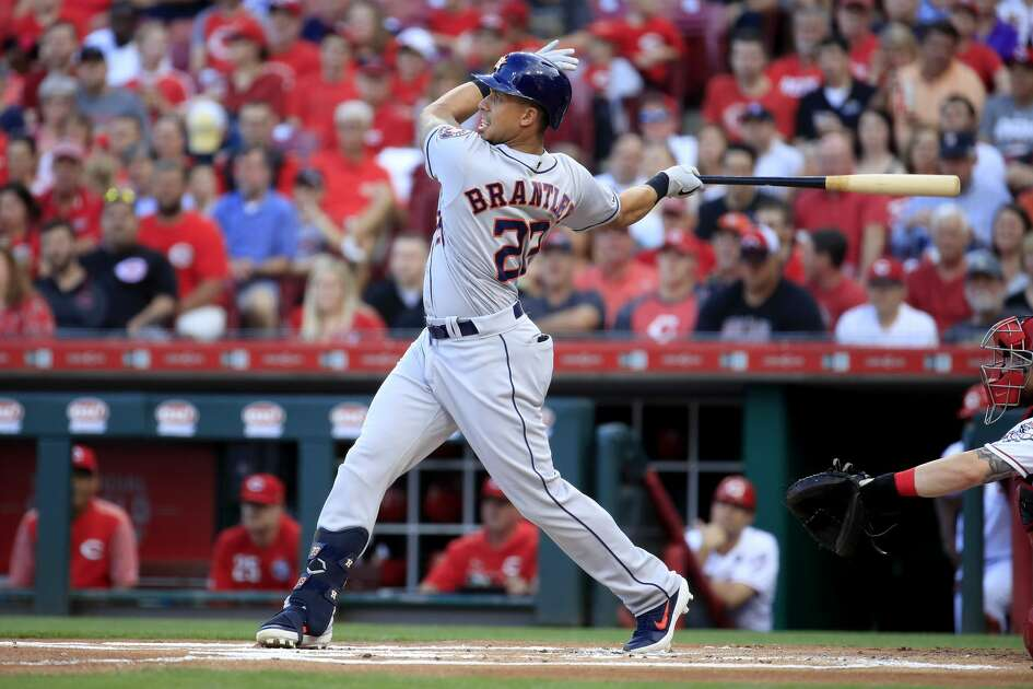 CINCINNATI, OHIO - JUNE 18: Michael Brantley #23 of the Houston Astros hits a single in the first inning against the Cincinnati Reds at Great American Ball Park on June 18, 2019 in Cincinnati, Ohio. (Photo by Andy Lyons/Getty Images)