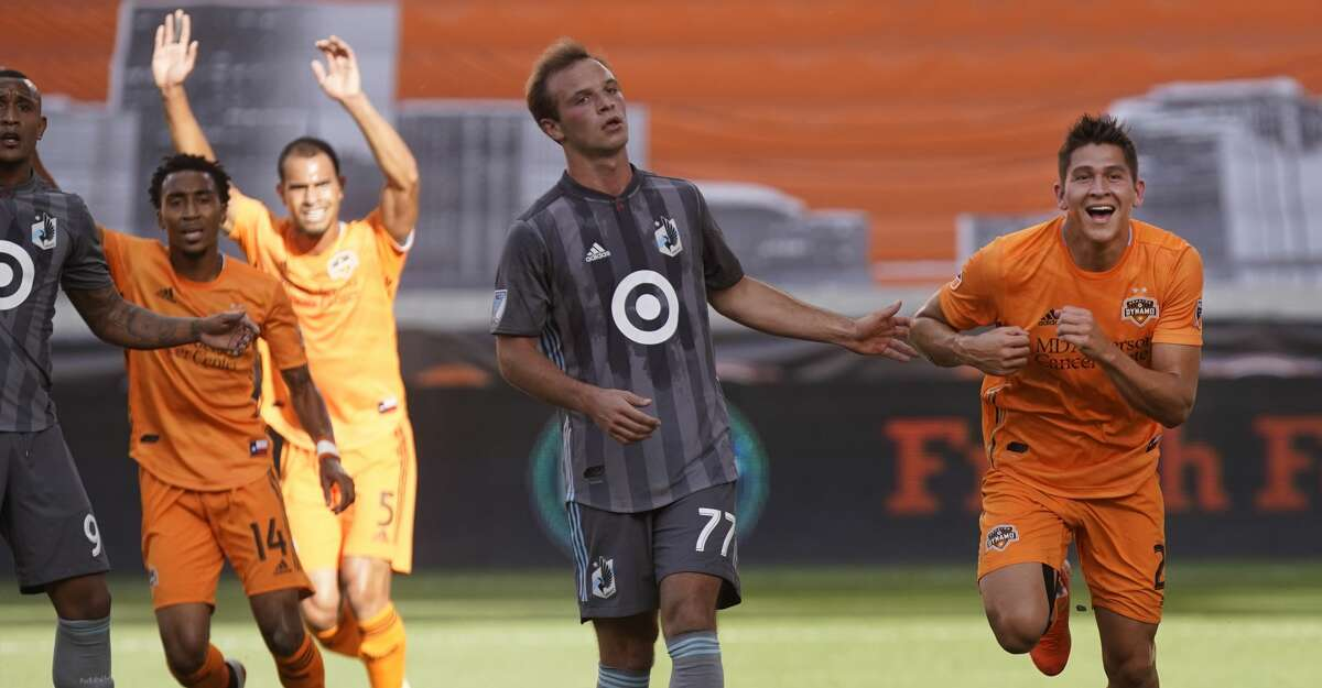 Houston Dynamo Ronaldo Pena, right, celebrates his goal against the Minnesota United FC during the first half of game at BBVA Stadium Tuesday, June 18, 2019, in Houston.