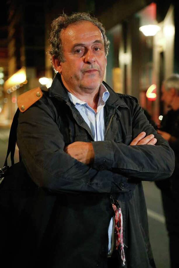 "Ex-UEFA chief Michel Platini leaves the Central Office for Combating Corruption and Financial and Tax Crimes after being arrested in connection with a criminal investigation into the award of the 2022 World Cup to Qatar, in Nanterre, west of Paris on June 18, 2019. - The banned ex-UEFA chief Michel Platini was freed from French custody Wednesday, an AFP journalist said, after several hours of questioning in connection with a criminal investigation into the awarding of the 2022 World Cup to Qatar. ""He is no longer in custody,"" William Bourdon, the lawyer of the French football legend, said shortly before 1:00 am. There had been ""a lot of fuss over nothing"", he added. (Photo by Zakaria ABDELKAFI / AFP)ZAKARIA ABDELKAFI/AFP/Getty Images Photo: ZAKARIA ABDELKAFI / AFP or licensors"