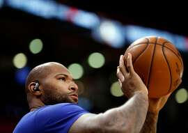 Golden State Warriors' DeMarcus Cousins warms up before playing Toronto Raptors in NBA Finals' Game 2 at ScotiaBank Arena in Toronto, Ontario, Canada, on Sunday, June 2, 2019.
