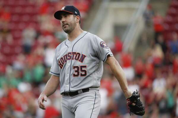 Astros pitcher Justin Verlander isn't pleased with himself after giving up a two-run first-inning homer to the Reds' Derek Dietrich.