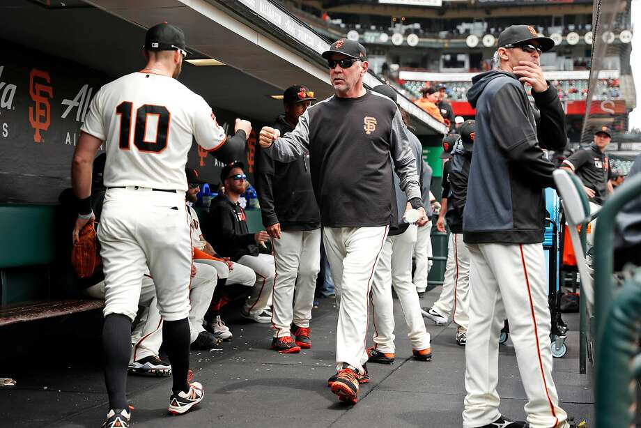 San Francisco Giants' manager Bruce Bochy fist bumps Evan Longoria before the Giants play Arizona Diamondbacks during MLB game at Oracle Park in San Francisco, Calif., on Sunday, May 26, 2019. Photo: Scott Strazzante / The Chronicle
