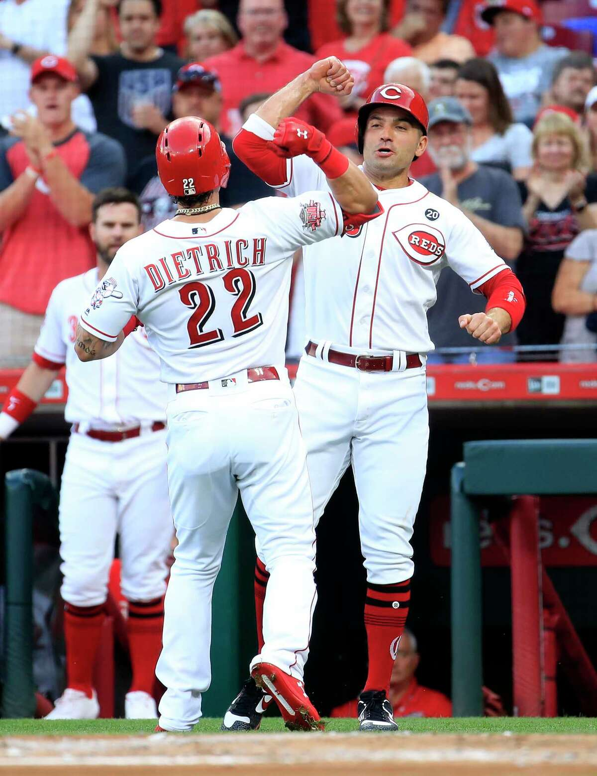 CINCINNATI, OHIO - JUNE 18: Derek Dietrich #22 of the Cincinnati Reds is congratulated by Joey Votto #19 after hitting a home run in the first inning against the Houston Astros at Great American Ball Park on June 18, 2019 in Cincinnati, Ohio. (Photo by Andy Lyons/Getty Images)