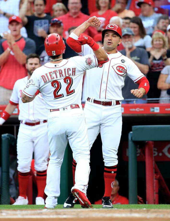 CINCINNATI, OHIO - JUNE 18:   Derek Dietrich #22 of the Cincinnati Reds  is congratulated by Joey Votto #19 after hitting a home run in the first inning against the Houston Astros at Great American Ball Park on June 18, 2019 in Cincinnati, Ohio. (Photo by Andy Lyons/Getty Images) Photo: Andy Lyons / 2019 Getty Images