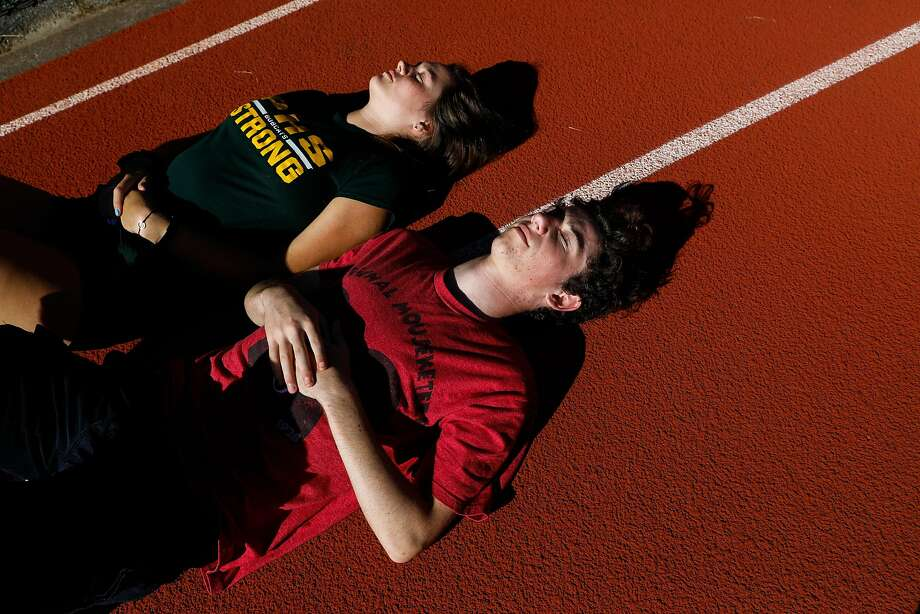 Lance (right) and girlfriend Ava Schnurr kick back on the track on grduation day at Paradise High School. She's going to college in Santa Barbara; he's moving five days after graduation. Photo: Gabrielle Lurie / The Chronicle