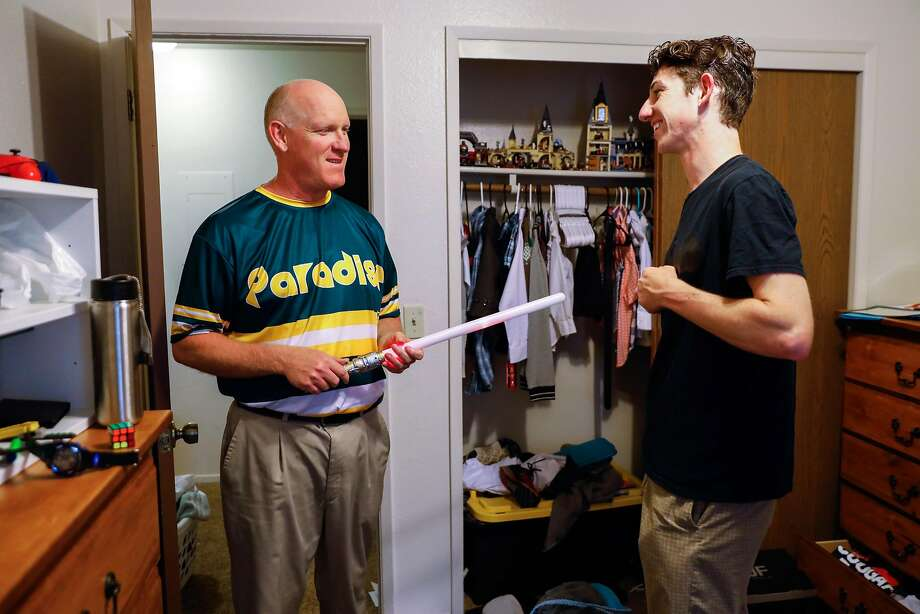 Loren Lighthall, Paradise High School principal, and son, Lance, a senior at the school, get ready for graduation at the family's temporary apartment in Chico, where they moved after their home was destroyed in the Camp Fire. Photo: Gabrielle Lurie / The Chronicle