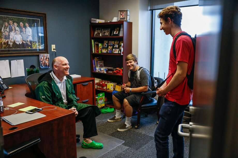 Lance and Loren, wearing his signature garish Crocs, chat as Lance's friend Ben Dees joins in the conversation. It is before graduation, and they are at the school in Chico where Paradise High moved after the Camp Fire. Photo: Gabrielle Lurie / The Chronicle