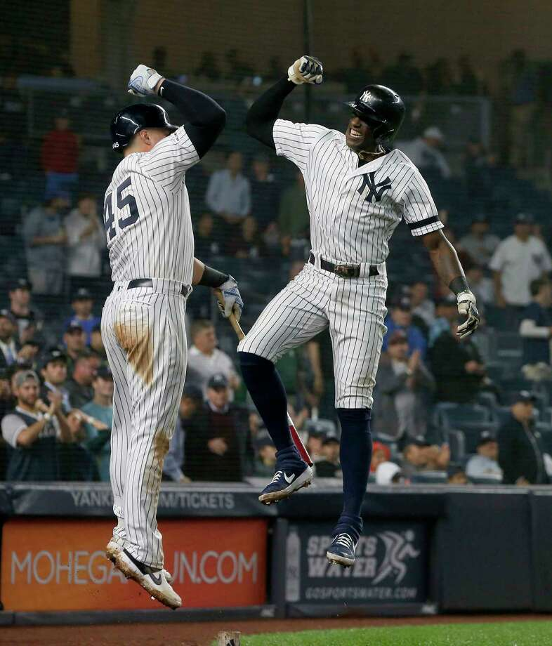 NEW YORK, NEW YORK - JUNE 18:   Cameron Maybin #38 of the New York Yankees celebrates his seventh inning home run against the Tampa Bay Rays with teammate Luke Voit #45 at Yankee Stadium on June 18, 2019 in New York City. (Photo by Jim McIsaac/Getty Images) Photo: Jim McIsaac / 2019 Getty Images