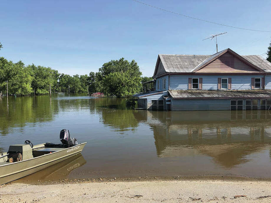 Although river levels are receding after weeks, the Kampsville Inn shows the extent of remaining flooding. Photo: Kathy Burkholder | Contributor