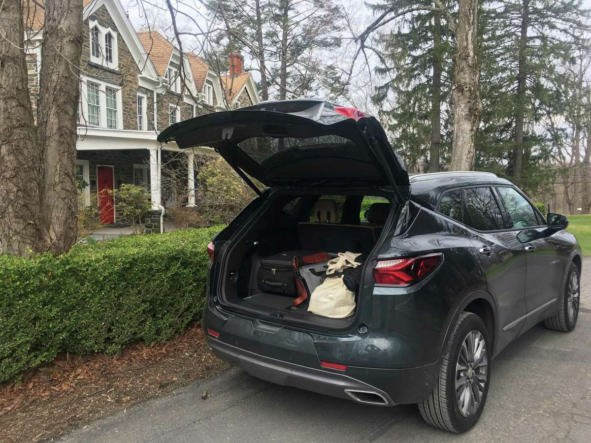 Guests pack up to leave Hasbrouck House for an excursion in the Hudson Valley.