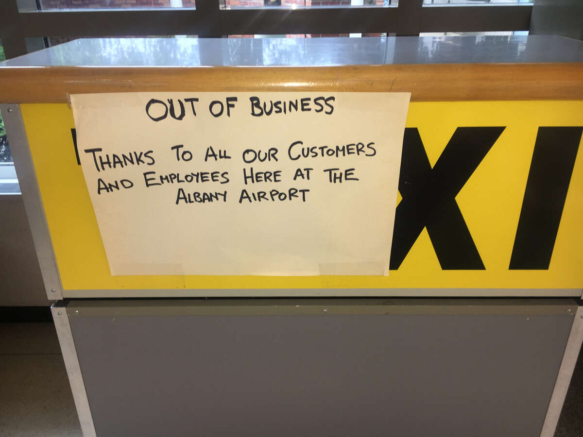 A sign on the kiosk for Capitaland Taxi at Albany International Airport confirms that the company's operation at the airport is over. Capitaland had already ended its overnight cab service at the airport.