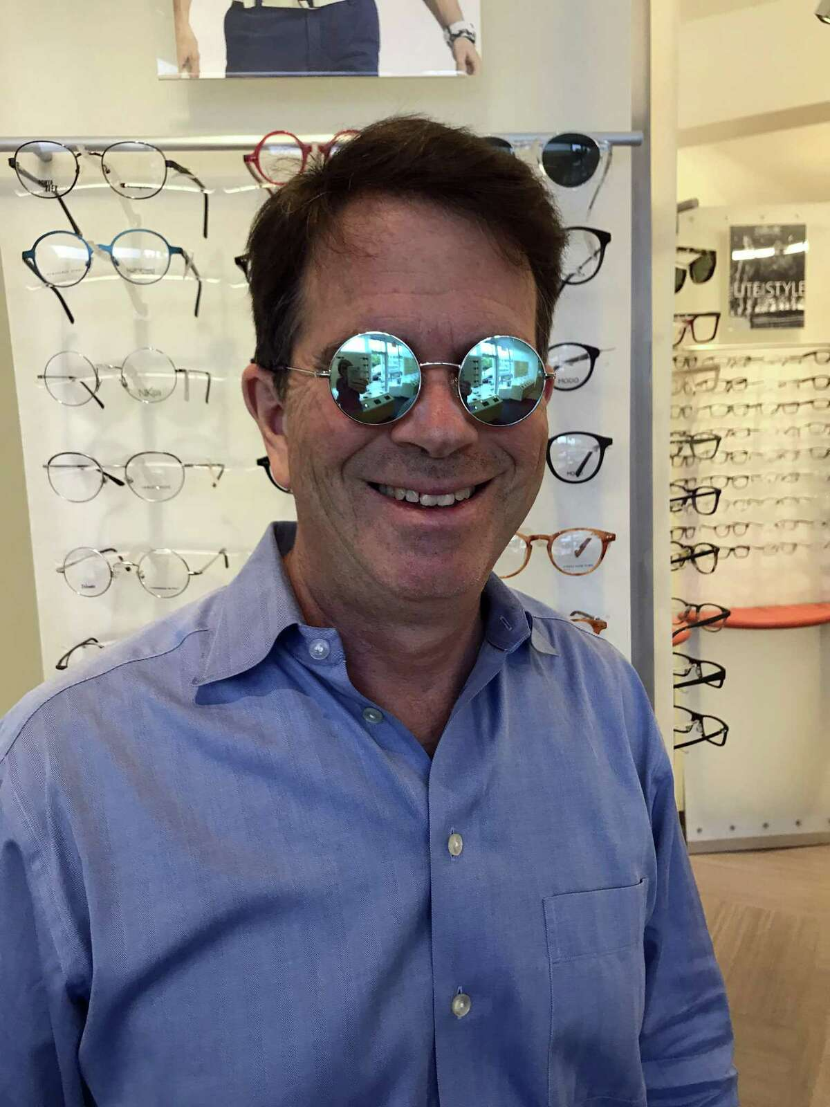 Mark Agnew in his new Pi Wear brand of eyeglasses. For every one pair of Pi Wair eyeglasses or sunglasses purchased, Eyeglass.com pays for one eye surgery in rural India