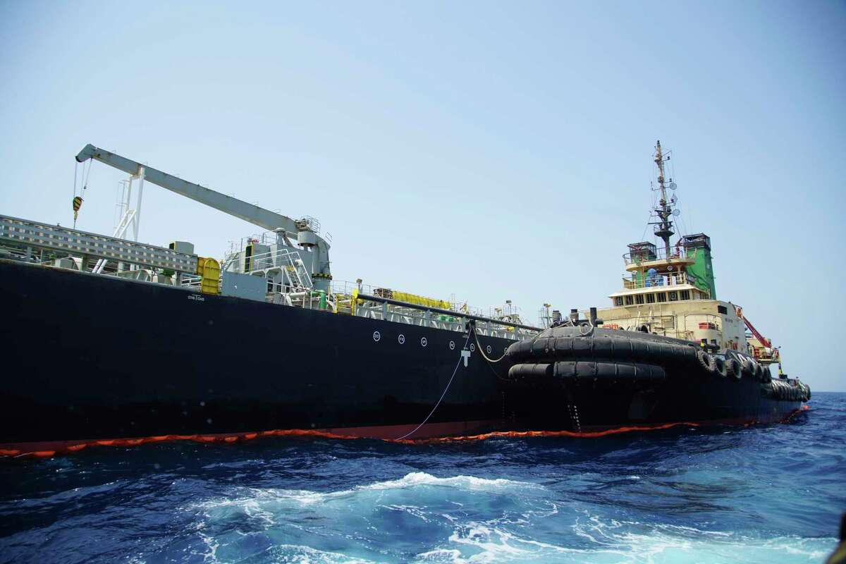The Panama-flagged, Japanese owned oil tanker Kokuka Courageous, that the U.S. Navy says was damaged by a limpet mine, is anchored off Fujairah, United Arab Emirates, during a trip organized by the Navy for journalists, Wednesday, June 19, 2019. The limpet mines used to attack the oil tanker near the Strait of Hormuz bore