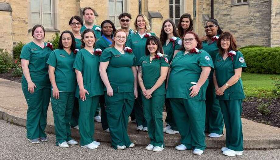 Graduates of the Southwestern Illinois College Medical Assistant program gathered recently at St. Peter's Cathedral in Belleville for the 2019 Health Sciences Pinning Ceremony. Graduates include: from left, front row, Amanda Blankenship of Waterloo, Jessica De La Cruz of Granite City, Brittany Sills of O'Fallon, Ashley McPherson of St. Jacob, Crissa Deatherage of Smithton, Nicole Slaven of Sparta, Julie Linskey of Belleville; second row, Tracy Vines of Freeburg, Imani Horton of Belleville, Jessica Kelly of Granite City, Kari Graumenz of Troy, Lindsay Caldwell of Swansea; third row, Edward Davidson of Maryville, John Jefferson of Mascoutah, Jennifer Gumber of O'Fallon. Photo: For The Intelligencer