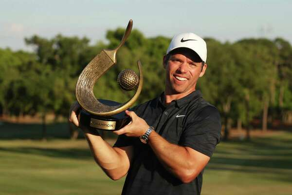 Paul Casey celebrates with the winner's trophy after the final round of the Valspar Championship in March.