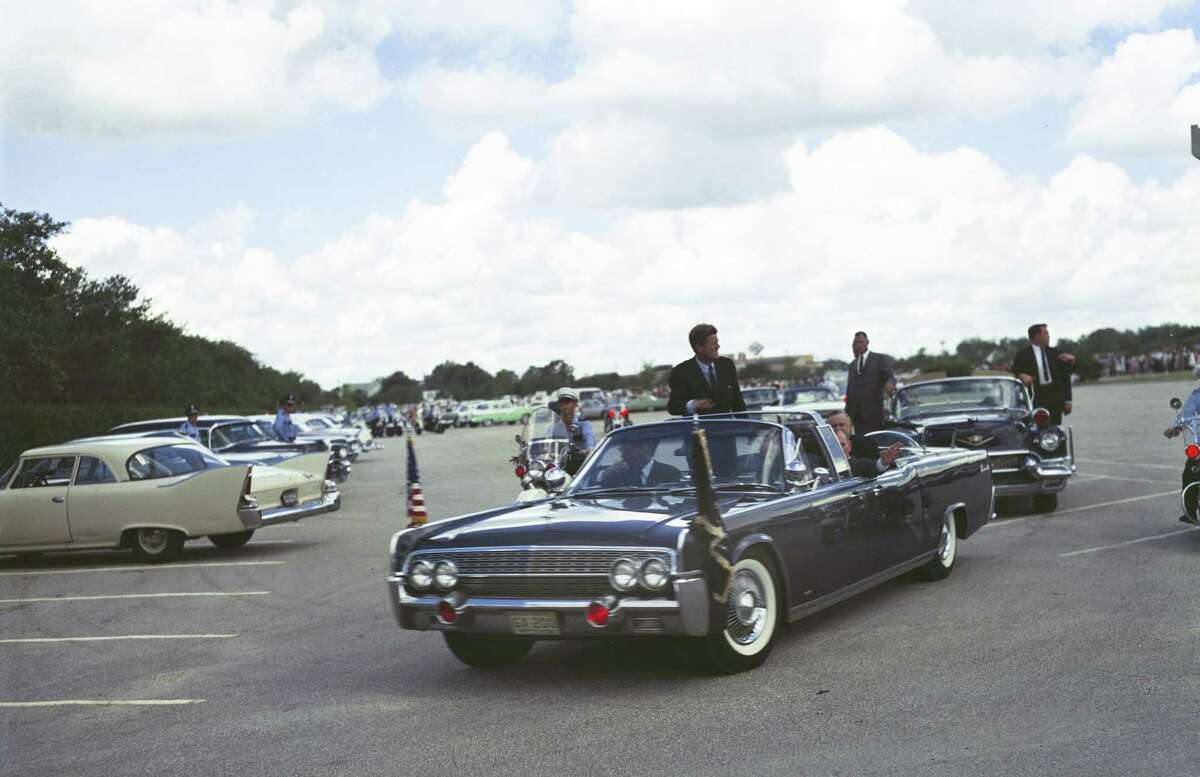 President John F. Kennedy can be easily recognized in this image photographed at the staging area of a 1962 parade featuring him in Houston.