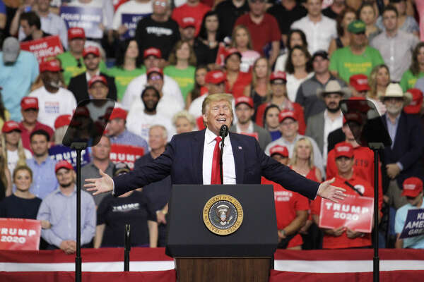 President Donald Trump gestures while speaking during a rally in Orlando, Florida, on June 18, 2019. For one night in a packed arena in Orlando, Trump tried to recapture the insurgent energy and anything-might-happen feel of the campaign that fueled his bid for the White House four years ago.