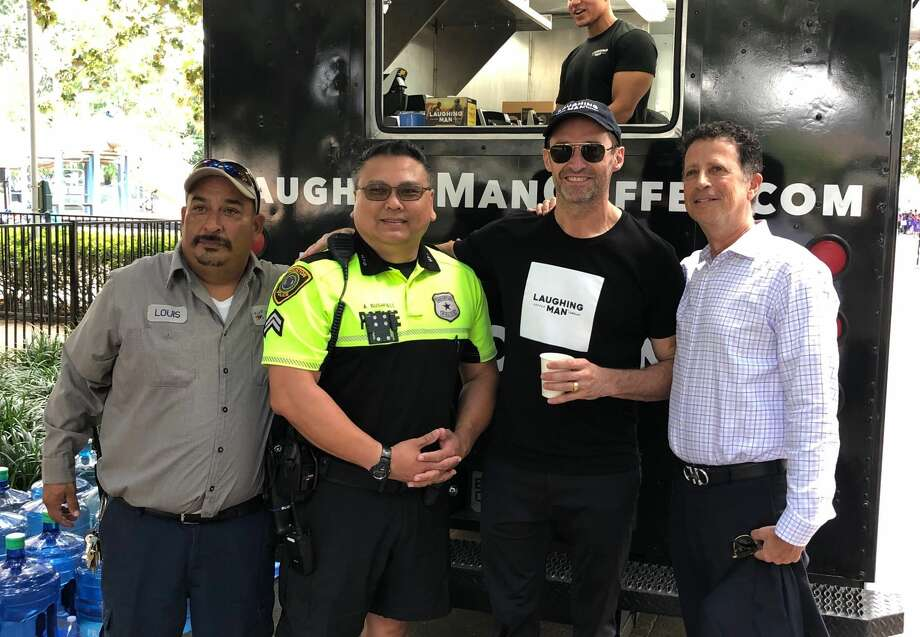 Visitors at downtown's Discovery Green were surprised to see Hugh Jackman handing out cups of coffee Tuesday. Photo: Courtesy
