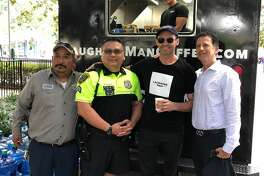 Visitors at downtown's Discovery Green were surprised to see Hugh Jackman handing out cups of coffee Tuesday.