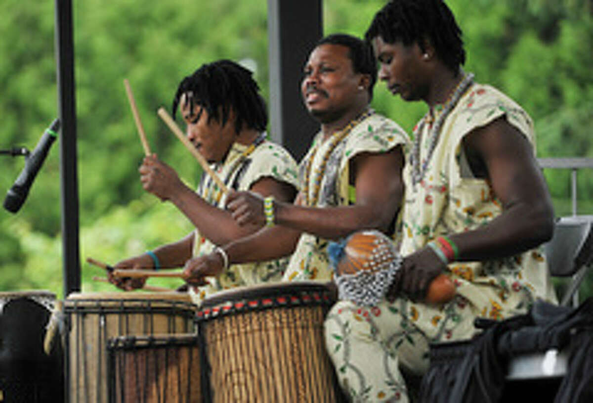 Members of the Tsoloi Ensemble perform a traditional African dance at the Juneteenth celebration at Washington Park on Sunday, June 12, 2016, in Albany.