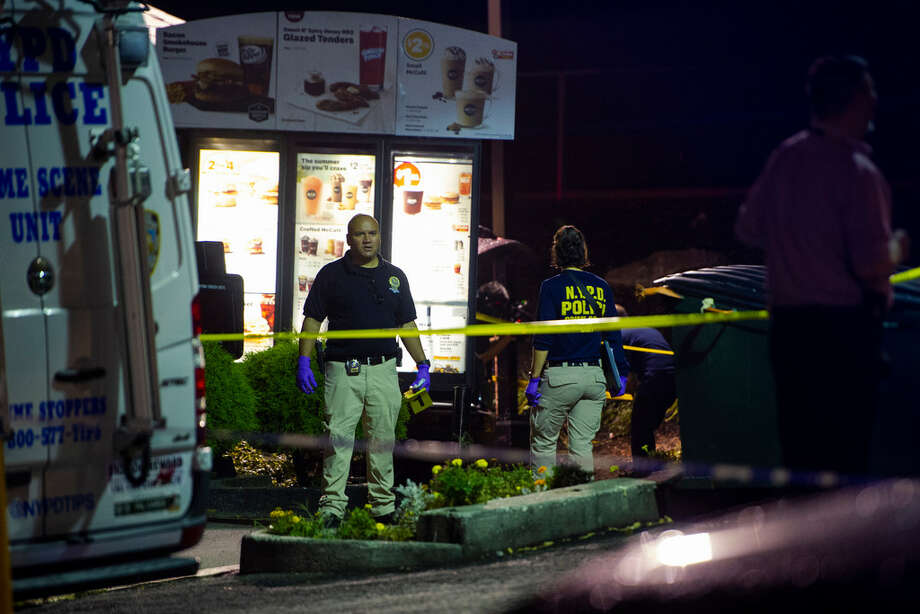 FILE -- Police investigate a drive-thru where mobster Sylvestre Zottola was assassinated, in the Bronx, Oct. 4, 2018. The mastermind of the killing, federal prosecutors now say, was actually a member of a family even closer to Zottola — his own son. Photo: Gregg Vigliotti/The New York Times