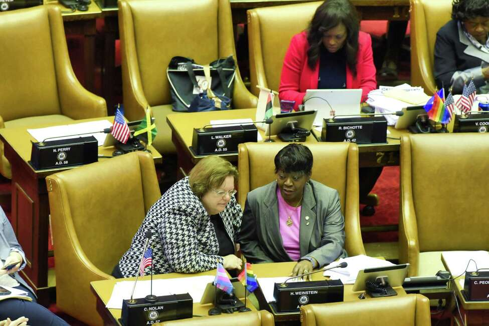 Assemblymember Cathy Nolan, left, and Assembly Majority Leader, Crystal Peoples-Stokes, talk on the floor of the State Assembly during debate of the Farmworker Fair Labor Practices Act on Wednesday, June 19, 2019, in Albany, N.Y. (Paul Buckowski/Times Union)
