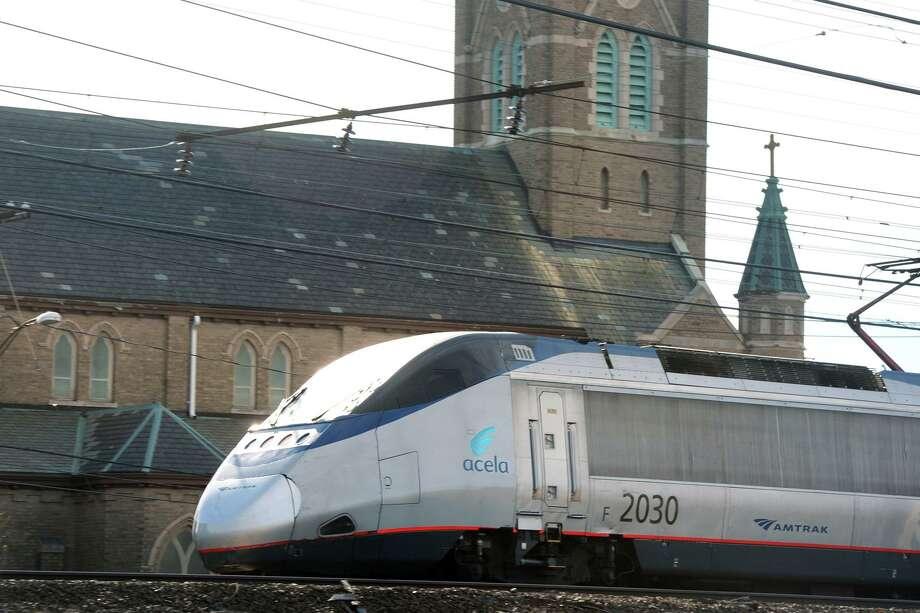 A Amtrak Acela train passes through Bridgeport. Photo: Ned Gerard / Hearst Connecticut Media / Connecticut Post